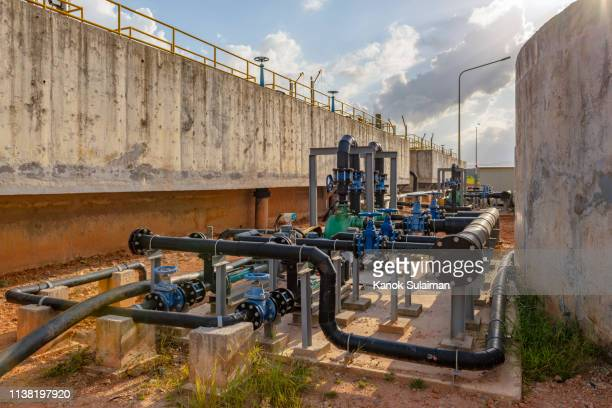heavy duty pump in water purification plant - air valve stock photos and pictures