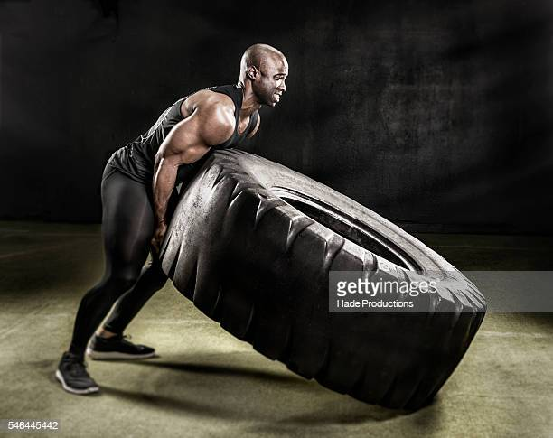heavy duty tire lift. - bodybuilding stockfoto's en -beelden