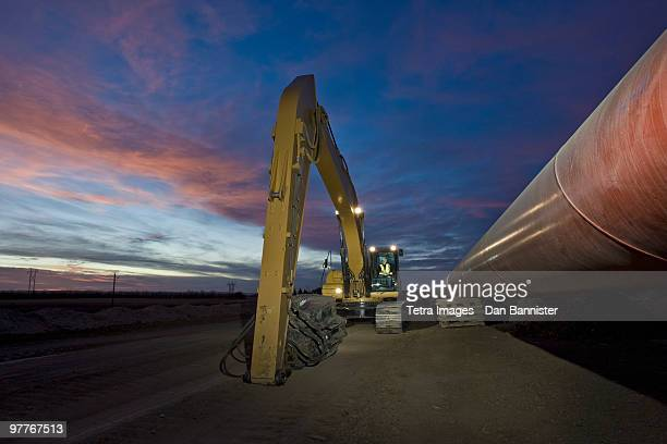 heavy equipment beside pipeline - karl lagerfield bildbanksfoton och bilder