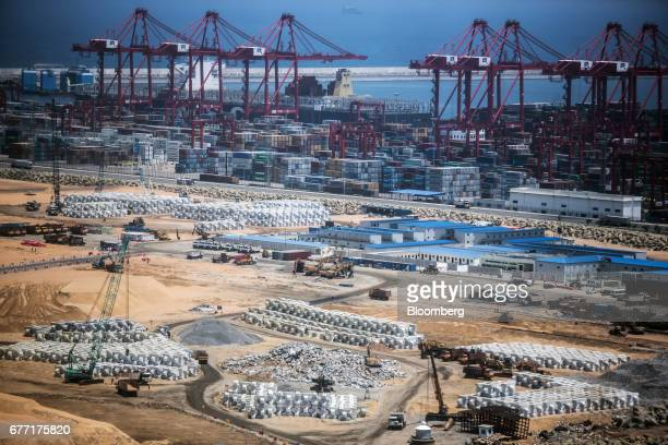 Heavy equipment construction materials and cranes stand at the construction site for the Colombo Port City development in Colombo Sri Lanka on Friday...