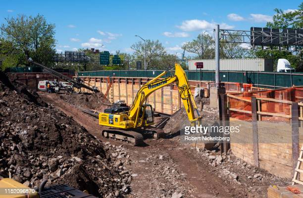 Heavy equipment digs out the foundation for a multi-story residential condominium building in the Cobble Hill neighborhood in Brooklyn, New York on...