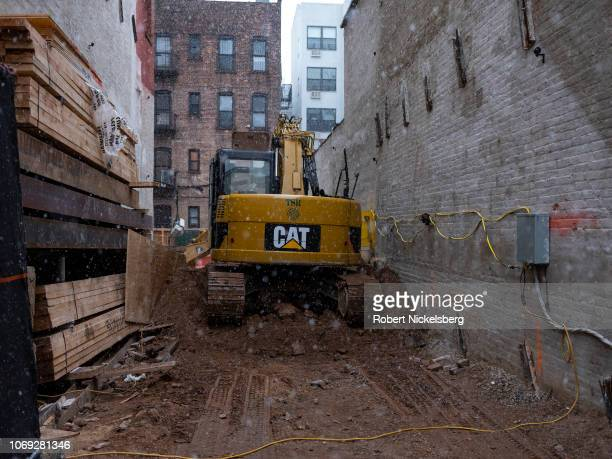 Heavy equipment excavates a residential building's foundation in Brooklyn, New York, November 15, 2018.