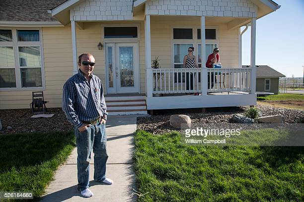 Heavy equipment operator Jesse Hall in front of his modular home on the edge of Williston North Dakota Mr Hall paid more than twice the normal price...