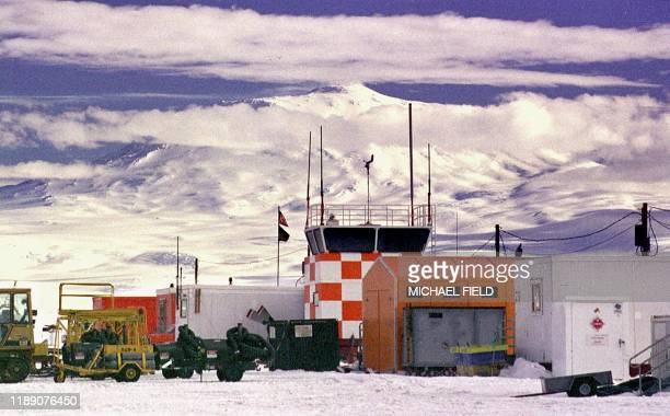 Heavy equipment sits in front of the control tower on standby to build special runways for skiequipped C130 Hercules airplanes coming in from trips...