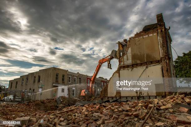 Heavy equipment takes down the sole remaining row house on N Bradford street on August 2016 in Baltimore MD