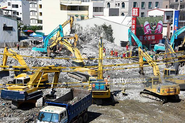 Heavy equipments are used to demolish the collapsed building on February 13 2016 in Tainan Taiwan Tainan city announced the termination of the...