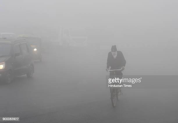 Heavy fog and smog infront of the Rajghat on December 31 2017 in New Delhi India Flight operations were affected at the Indira Gandhi International...