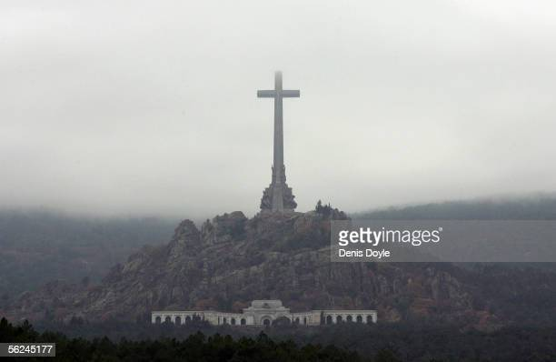 A heavy fog lies over the Valle de los Caidos monument on the 30th anniversary of the death of Spanish dictator Gen Francisco Franco on November 20...