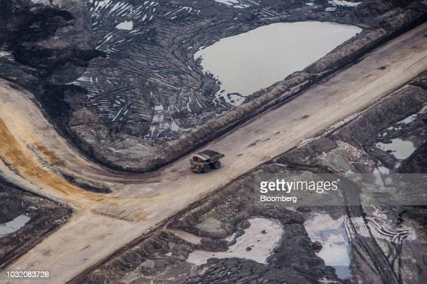 A heavy hauler truck drives through the Suncor Energy Inc Millennium mine in this aerial photograph taken above the Athabasca oil sands near Fort...