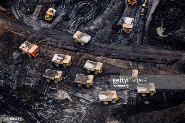 Heavy haulers are seen at the Suncor Energy Inc Fort Hills mine in this aerial photograph taken above the Athabasca oil sands near Fort McMurray...