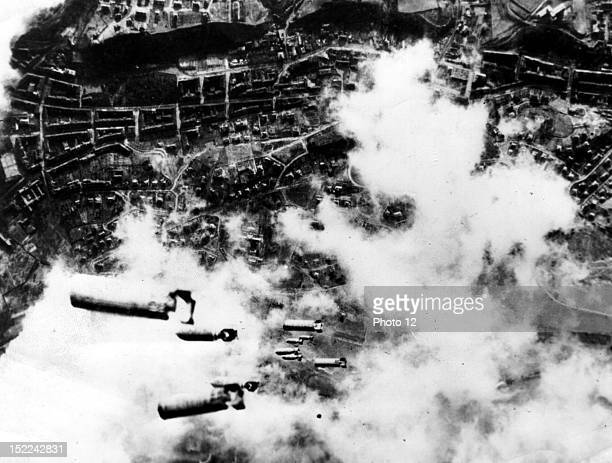 Heavy incendiary bombs together with high exposives fall toward the city of Dresden seen burning below as bombers of the 8th US Air Force attack the...