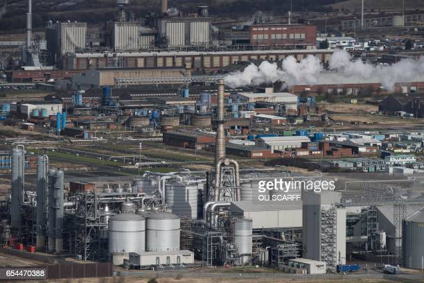 Heavy industry adjacent to the river Tees is seen from the top of the outcrop Eston Nab overlooking Middlesbrough northern England on March 8 2017 /...