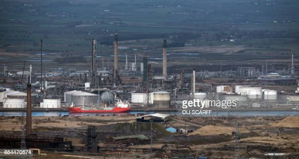 Heavy industry adjacent to the river Tees seen from the top of the outcrop Eston Nab overlooking Middlesbrough northern England on March 8 2017 / AFP...