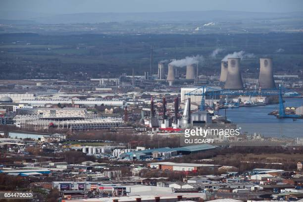 Heavy industry the Tees Transporter Bridge and Middlesbrough Football Club's Riverside Stadium are seen from the top of the outcrop Eston Nab...