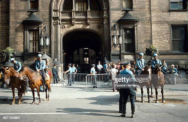 Heavy law enforcement presence outside The Dakota the apartment complex where John Lennon lived and was killed is photographed December 9 1980 in New...