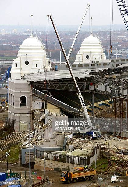 Heavy lifting equipment moves in to begin the demolition work on the twin towers at Wembley Stadium in London 06 December 2002 One of the most famous...