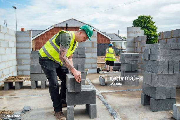heavy lifting on site - construction industry stock pictures, royalty-free photos & images