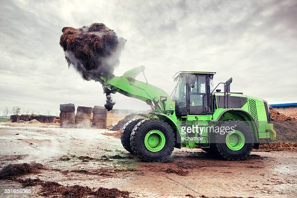 Heavy loader carrying food growing compost