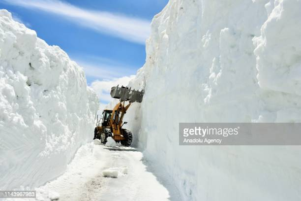 A heavy machine cleans out the snowcovered Cavustepe road that was closed for 6 months due to heavy weather conditions in Turkey's eastern Mus...