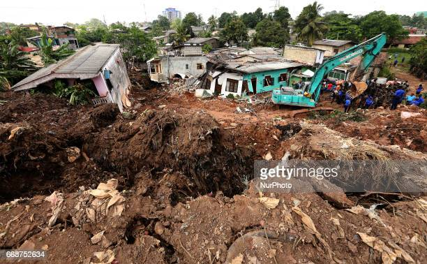 Heavy machinery are used by Sri Lanka Army personnel during rescue operations at the collapsed garbage mountain in Meethotamulla Colombo Sri Lanka 15...