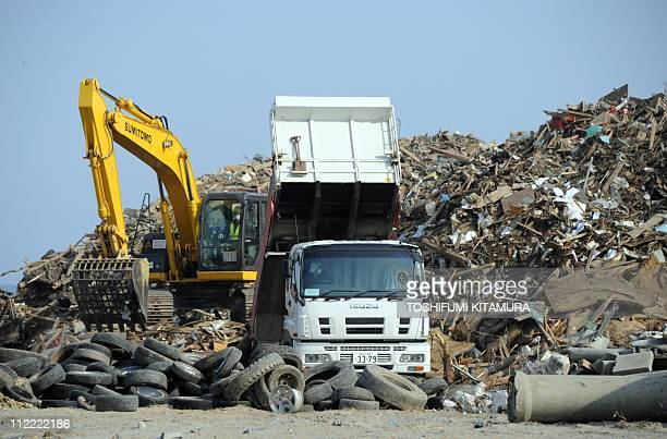 Heavy machinery cleans up tsunami devastation at the sea side area in Rikuzentakata city Iwate prefecture on April 15 2011 Japan's seismologists were...
