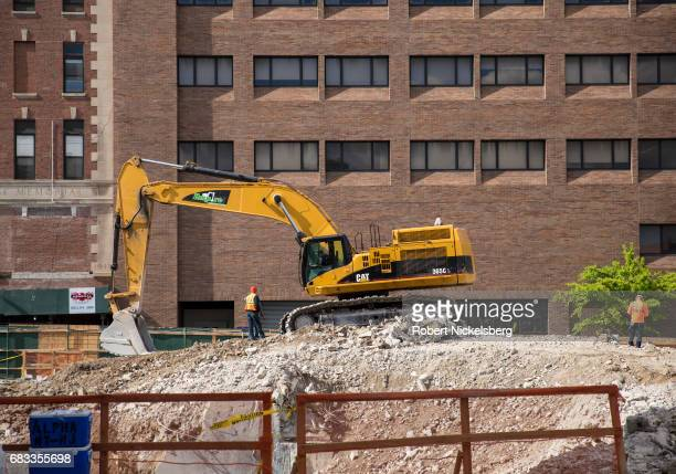 Heavy machinery continues to excavate the foundation of the former Long Island College Hospital May 12 2017 in the Brooklyn borough of New York The...