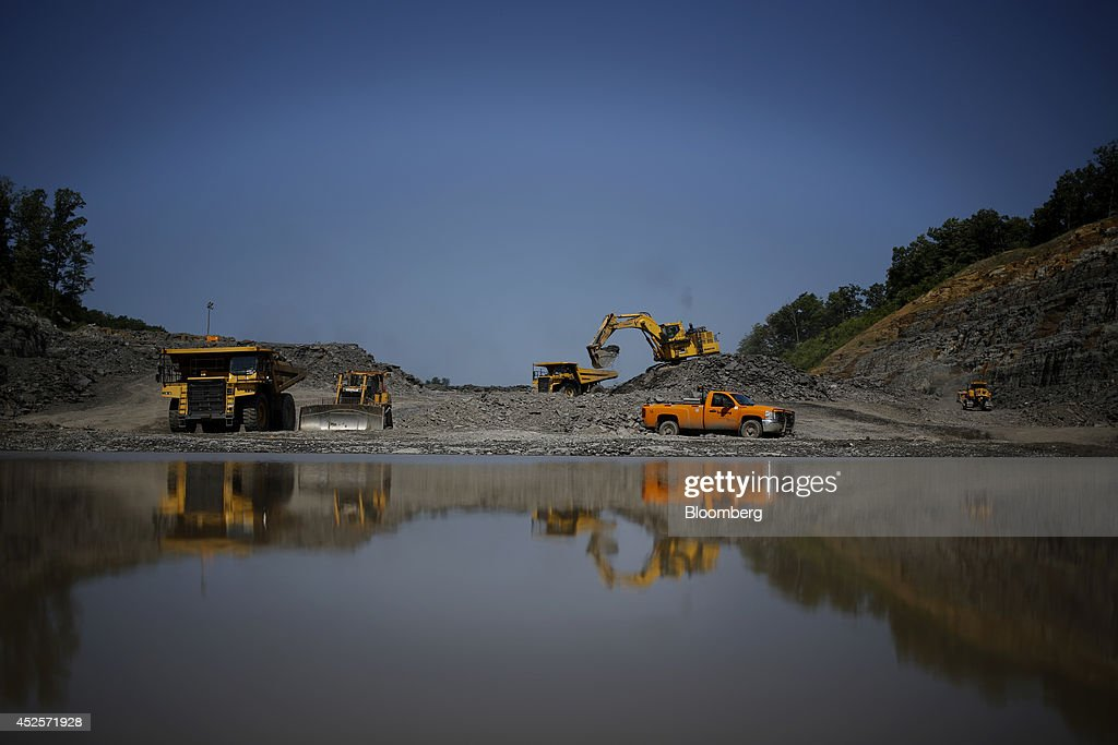 Heavy machinery distributes loads of blasted rock during the construction of a new segment of U.S. Highway 460, part of the Appalachian Development Highway System, under construction near the Virginia border in Elkhorn City, Kentucky, U.S. on Tuesday, July 22, 2014. Senate Democrats may bring to the floor a House-passed measure that would replenish federal funds for highway and mass-transit projects through May 2015. As part of that debate, senators could vote on two Democratic alternatives, although leaders say the House measure is more likely to prevail. Photographer: Luke Sharrett/Bloomberg via Getty Images