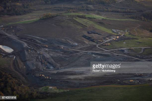 Heavy machinery moves earth for the foundation of a cryogenic natural gas processing plant October 26, 2017 in Smith Township, Washington County,...
