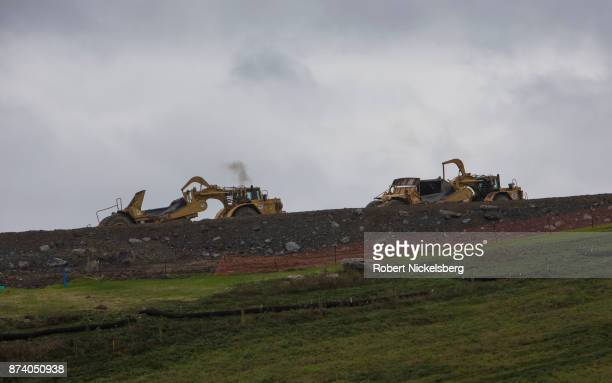Heavy machinery moves earth for the foundation of a natural gas cryogenic processing plant October 25 2017 in Smith Township Washington County...