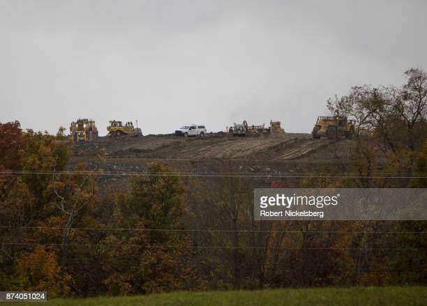 Heavy machinery moves earth for the foundation of a natural gas cryogenic processing plant October 25, 2017 in Smith Township, Washington County,...