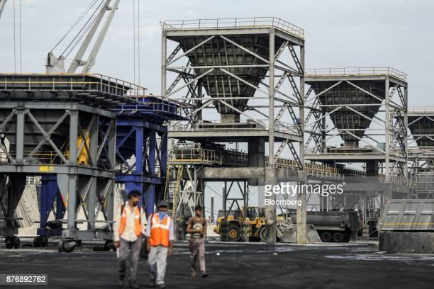 Heavy machinery sits dockside at Krishnapatnam Port in Krishnapatnam Andhra Pradesh India on Saturday Aug 12 2017 Growth in gross domestic product...