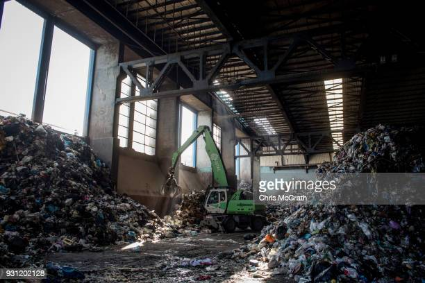 Heavy machinery sorts through waste as it arrives at the Odayeri Recycling and Compost Waste Facility on March 12 2018 in Istanbul Turkey Istanbul's...