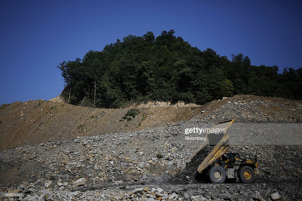 Heavy machinery unloads displaced rock below a new segment of U.S. Highway 460, part of the Appalachian Development Highway System, under construction near the Virginia border in Elkhorn City, Kentucky, U.S. on Tuesday, July 22, 2014. Senate Democrats may bring to the floor a House-passed measure that would replenish federal funds for highway and mass-transit projects through May 2015. As part of that debate, senators could vote on two Democratic alternatives, although leaders say the House measure is more likely to prevail. Photographer: Luke Sharrett/Bloomberg via Getty Images