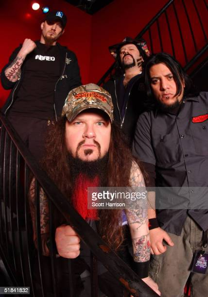 Heavy metal band Damageplan poses for a portrait backstage April 7, 2004 in Chicago, Illinois. Guitarist Dimebag Darrell , real name Darrell Abbott,...