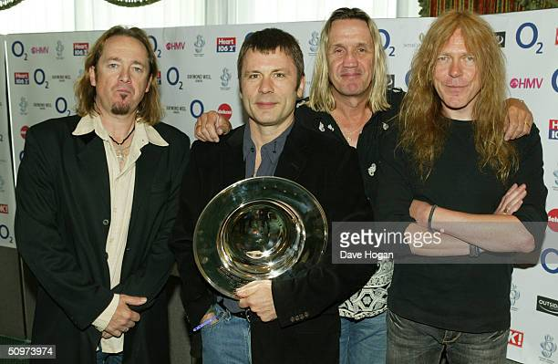 Heavy Metal band Iron Maiden Adrian Smith Bruce Dickinson Nicko McBrain and Janick Gers pose in the pressroom with the Deluxe Space Special...