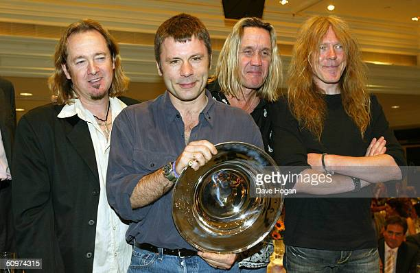 Heavy Metal band Iron Maiden pose with the Deluxe Space Special Achievement Award at the NordoffRobbins O2 Silver Clef Awards Lunch at the...