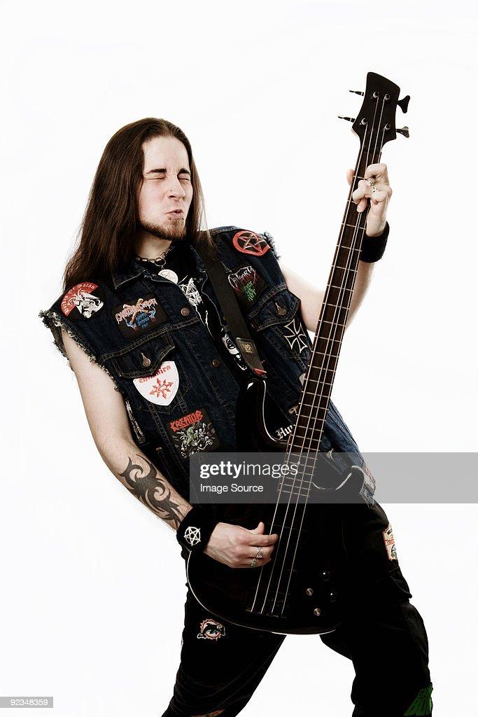 Heavy metal bass player : Stock Photo