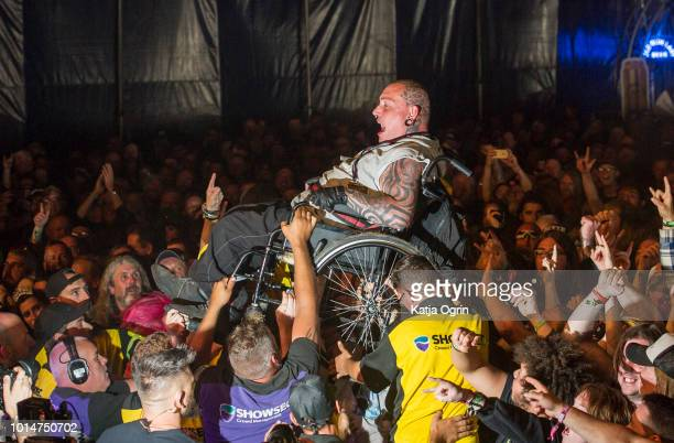 Heavy metal fan in a wheelchair crowdsurfs at Bloodstock Festival at Catton Hall on August 10 2018 in Burton Upon Trent England