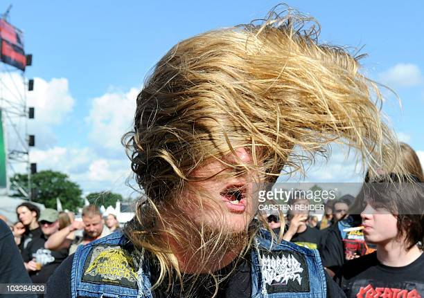Heavy metal fans dance as they listen to the bands at the open air Heavy metal music festival in the northern German city of Wacken on August 6 2010...