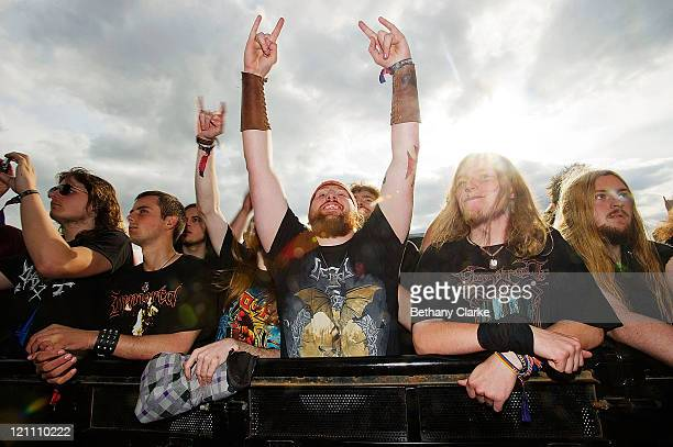 Heavy metal fans dance to the music at the Bloodstock festival on August 13 2011 in WaltononTrent United Kingdom Bloodstock is the UK's largest heavy...