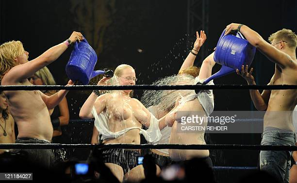 Heavy metal fans take part in a wet tshirt contest at the music festival in Wacken northern Germany on August 6 2011 More than 75000 visitors are...
