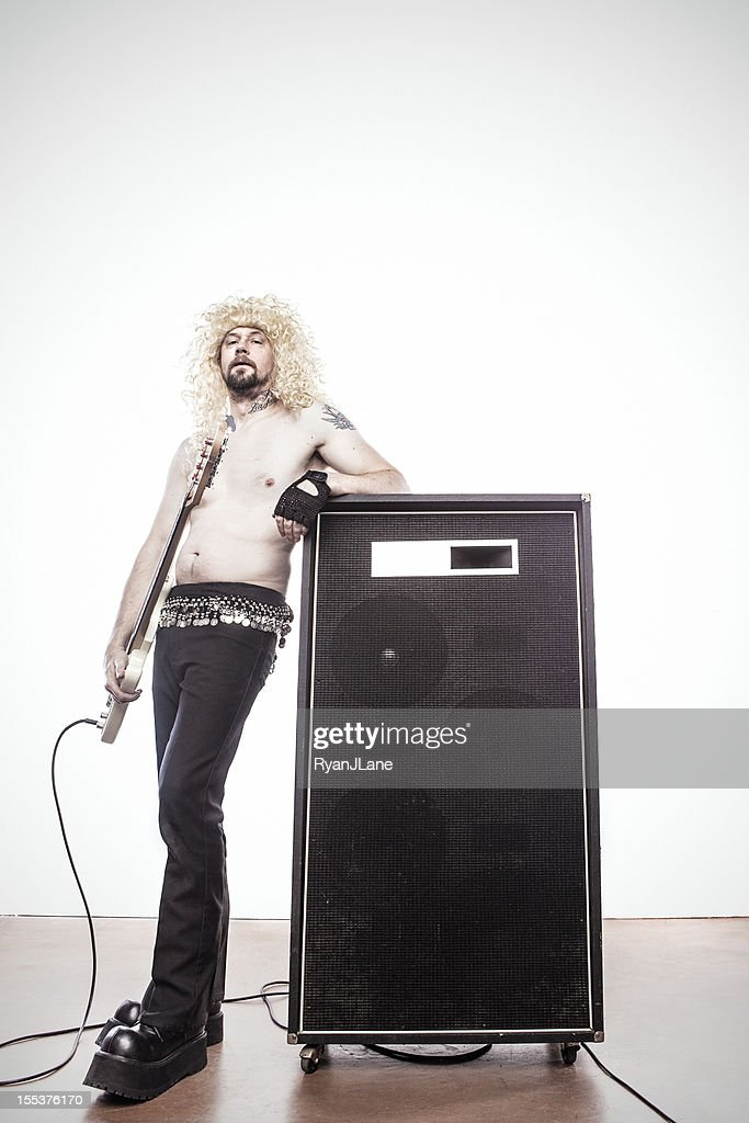 Heavy Metal Guitar Player Leaning on Amp : Stock Photo