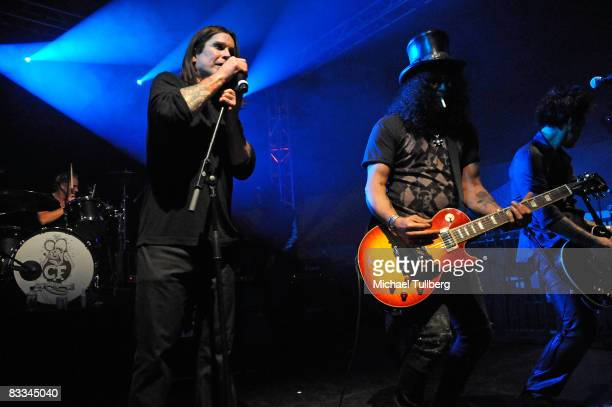 Heavy metal legend Ozzy Osbourne and Velvet Revolver guitarist Slash perform with allstar cover band Camp Freddy at the benefit grand opening of...