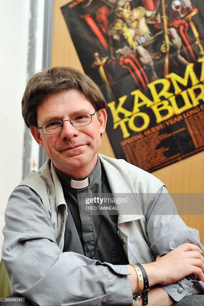 Heavy Metal music fan French priest Robe : News Photo