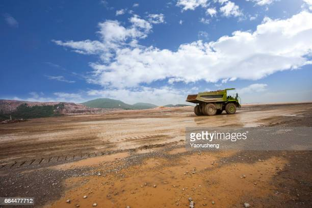 Heavy mining truck driving on the mining site,Pingshuo China