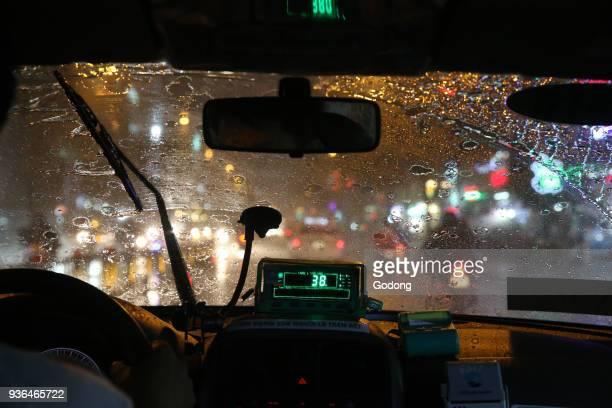 Heavy monsoon rain on Saigon Street Inside a taxi Vietnam