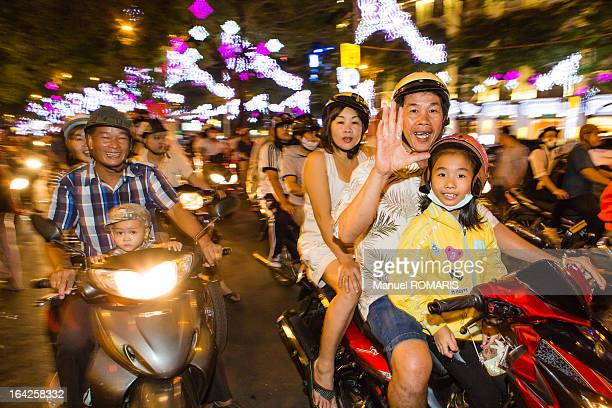 CONTENT] Heavy motorbike city traffic at night in Ho Chi Minh City Vietnam