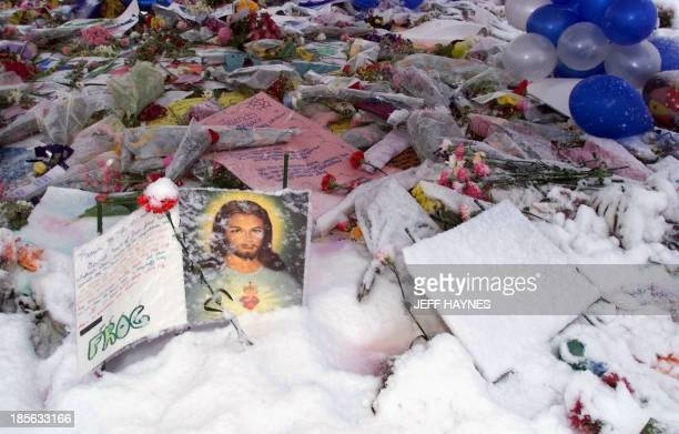 A heavy overnight snowfall covers one of the makeshift memorials 22 April 1999 in Littleton CO A vigil was held in honor of the 14 students and one...