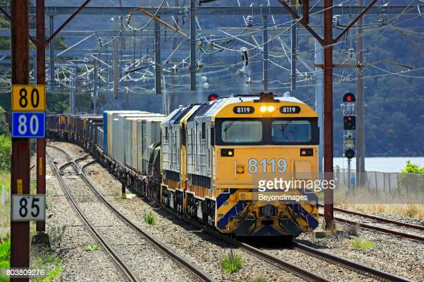 Heavy Pacific National diesel freight train in suburban Sydney