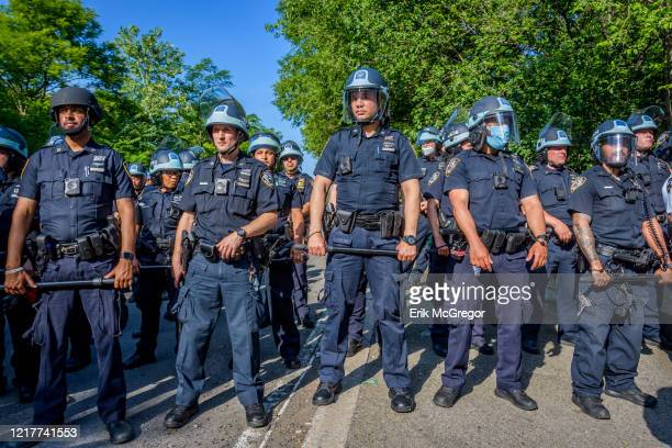 Heavy police presence around the protest area. Protesters by the thousands converged at Grand Army Plaza in Brooklyn marching down Flatbush Avenue to...